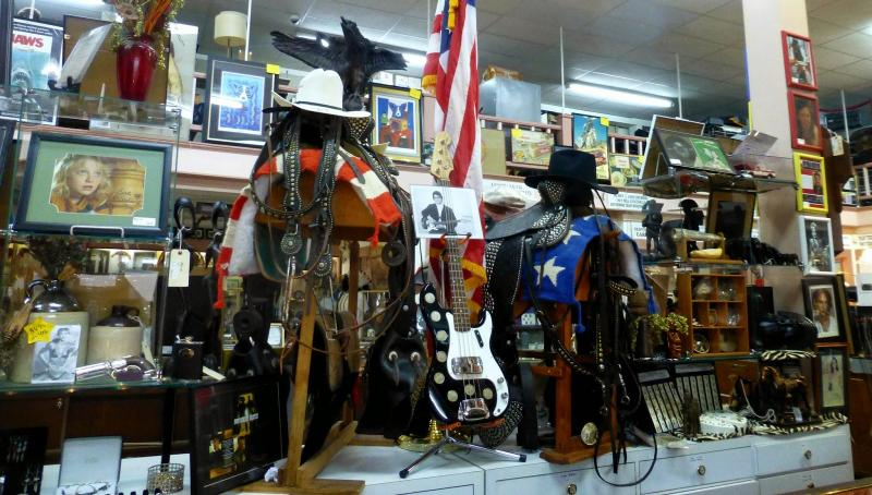 One aisle of the massive Silver Dollar Pawn Store in Alexandria, displaying pop culture memoribilia.