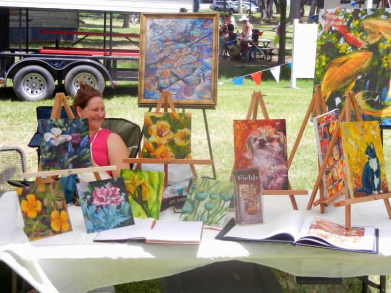 "Artists show off their creations at the Ben Wheeler ""Far Out Art Fest"" held in June."