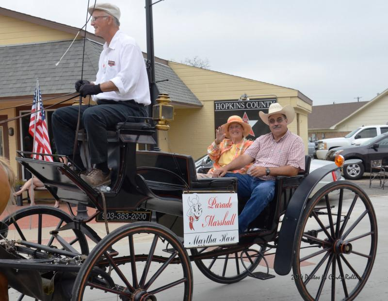 Parade marshal Martha Hare greets onlookers at the Hopkins County Dairy Festival parade in Sulphur Springs on June 14.