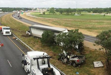 Officials said the driver of the pickup was headed the wrong way in the eastbound lanes.