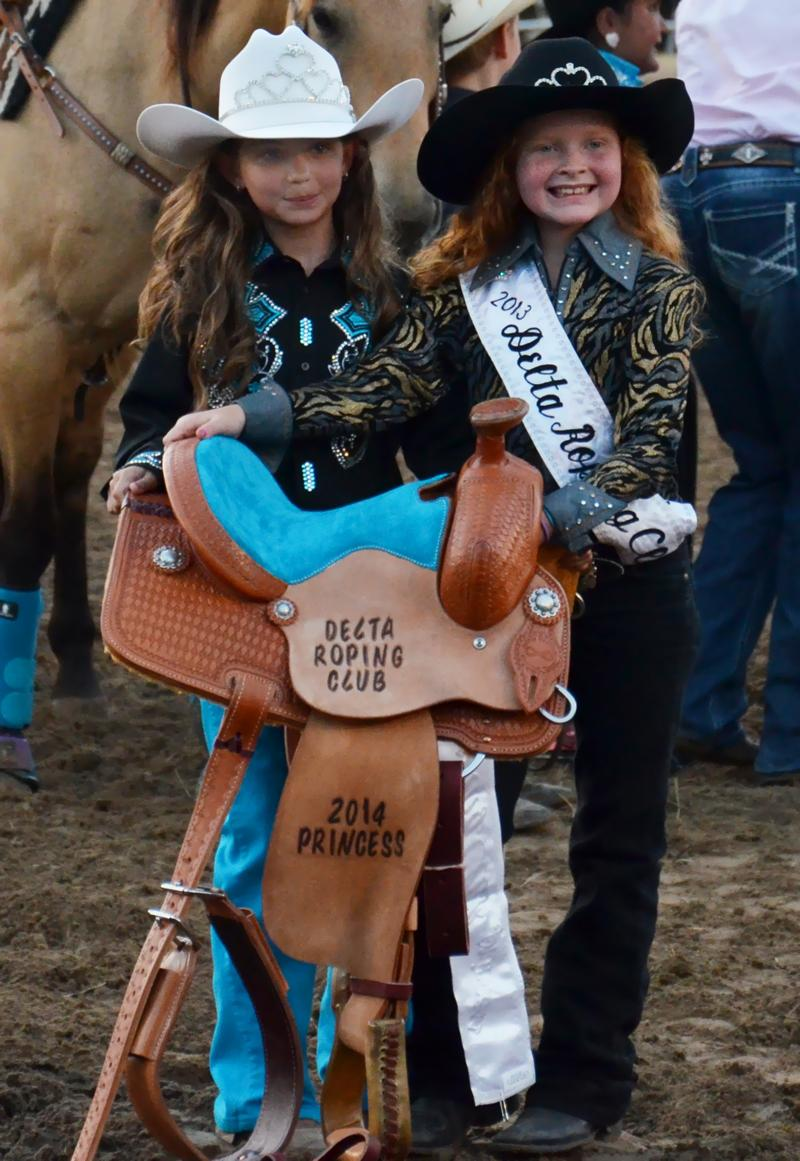 """Rodeo royals"" pose with a ceremonial saddle at the 2014 Cooper Rodeo."