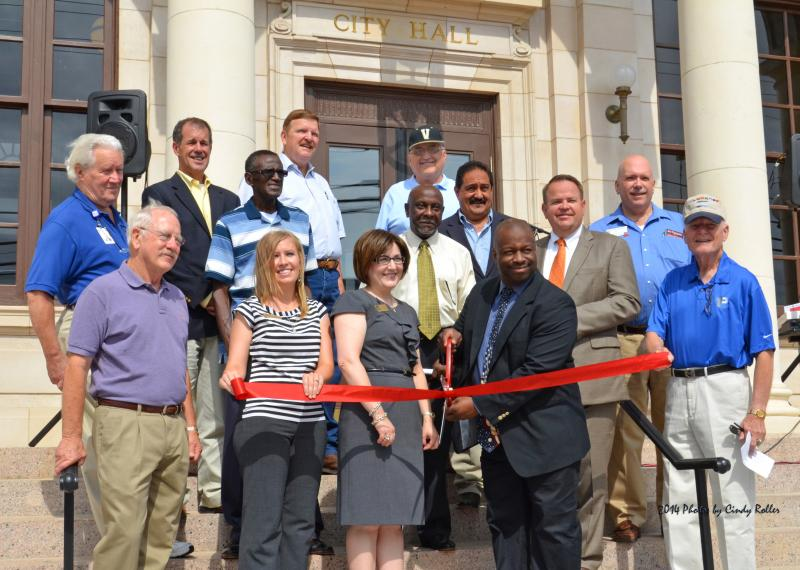 Sulphur Springs Mayor Freddie Taylor and other local officals and businesspeople attended the ribon cutting for the city's 100-year-old City Hall.