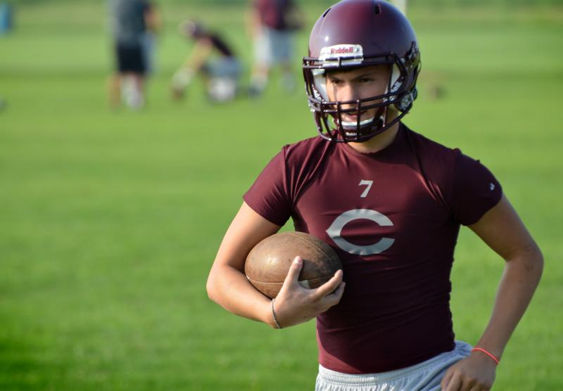 Senior Dally Warner warms up with Bulldog teammates on the first day of football practice.