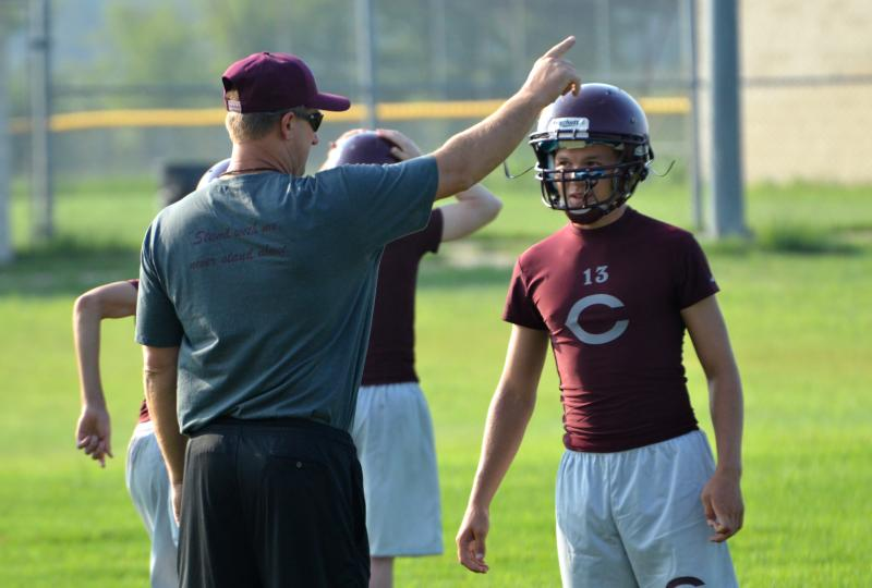 Cooper Bulldog Head Football Coach Ronnie Green guides players on the first day of practice.