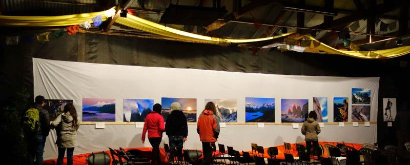 Film Festival attendees view photos displayed in the venue at Puerta Natales, Chile