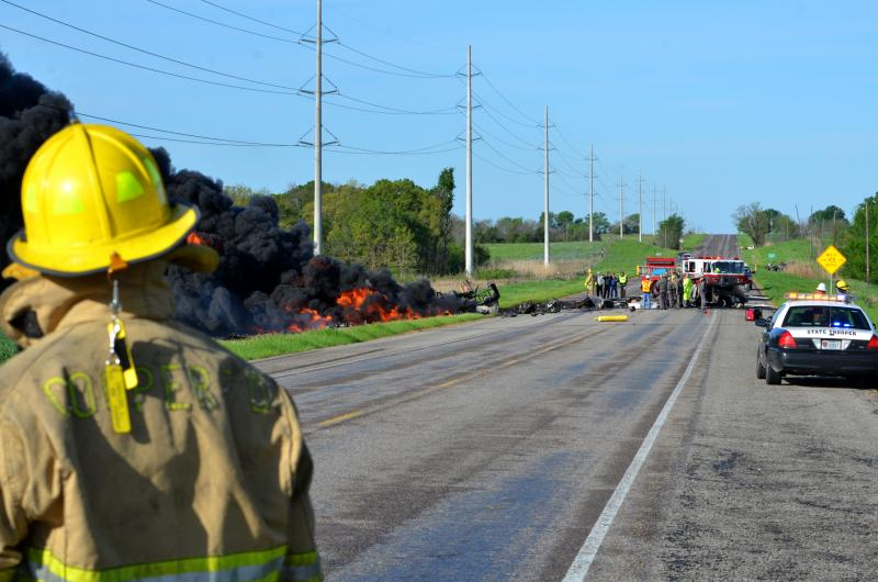 CVFD Lewis Taylor monitors the flames from a crash on State Highway 24 in Cooper.