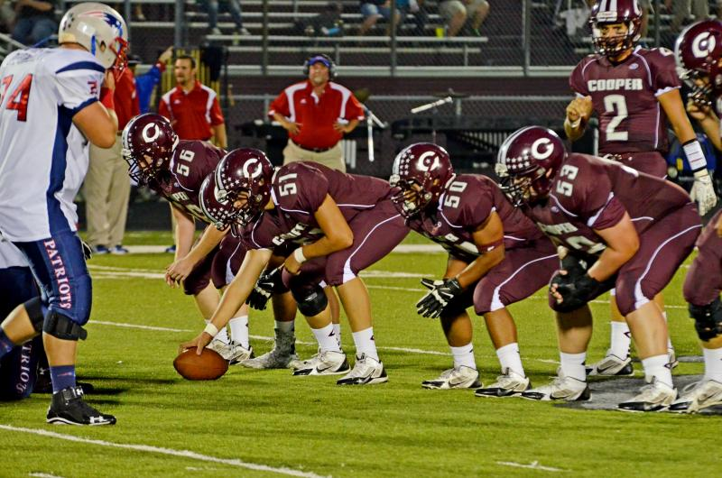 Bulldog offensive line comprised of Zach Jester (56), Justin Gibson (30), John Vaughn (51), Casey Mims (50), Skyler Sharpton (53) and quarterback Jadon McGraw (2) gets ready to take on the Prairiland Patriots last Friday.