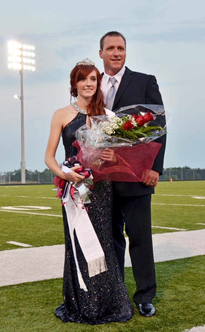 2014 Cooper Homecoming Queen Kelcie Stager is escorted by her father Patrick.