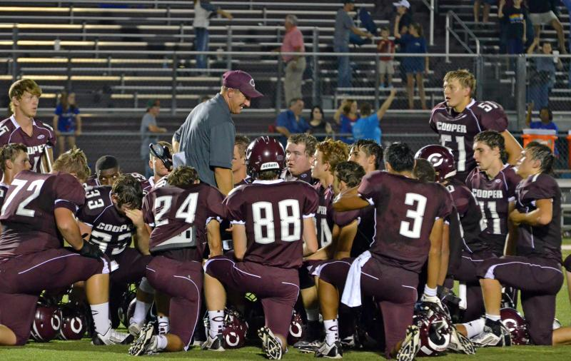 Bulldogs Head Football Coach Ronnie Green huddles with the team following the 30-7 Homecoming victory.