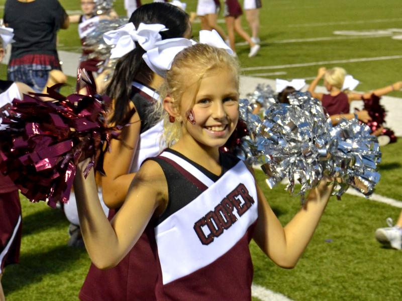 Cooper Youth Cheerleader Amy Holt cheers for her favorite team, the Bulldogs.