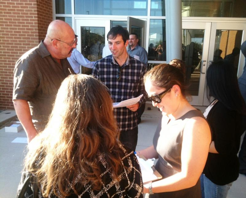 Activists present anti-toll road literature and petitions to vistors at the Sept. 22 public meeting in Rockwall.