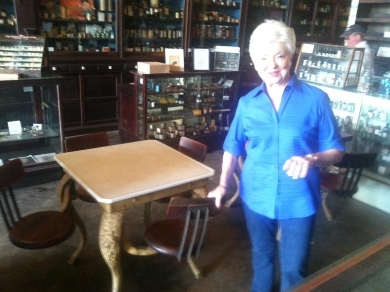 Sandra Johnson shows off some of the vintage furnishings at Roxton's Drug Store Museum, which will be open during the festival.