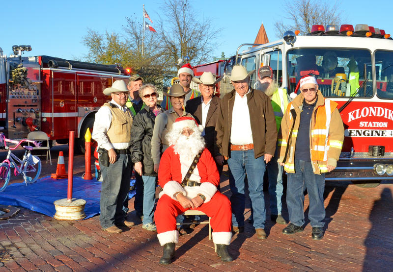 Santa helped the local law enforcement and volunteer fire fighters collect toys on the Square in Cooper for their Blue and Red Santa event.
