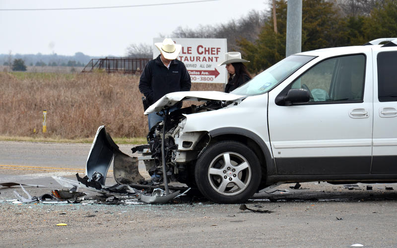 Delta County Sheriff's Deputies examine the damage at the scene of an accident at SH 24 and FM 64 in Cooper.