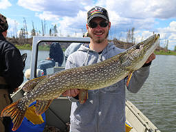 A visitor shows off a large fish caught at the Cree River Lodge in Canada. Lodge Owner Pat Babcock joins Luke this week to talk summer fishing in Canada.