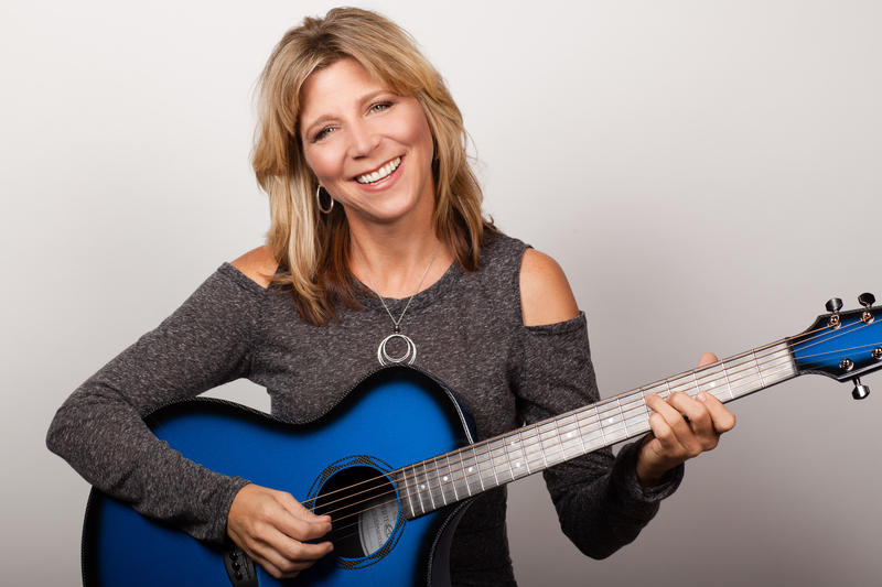 Terri Hendrix with blue acoustic guitar