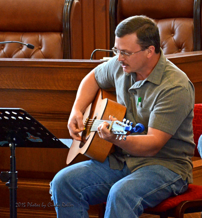 Guitarist Joe Clark performs his original song for Terri Hendrix and Lloyd Maines at Sunday afternoon's Crossroads Music Company workshop held at Sulphur Springs City Hall Chamber Listening Room.