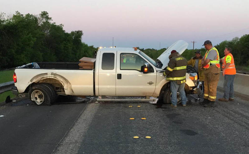First responders survey the accident which occurred early Monday morning on State Highway 24 in Delta County.