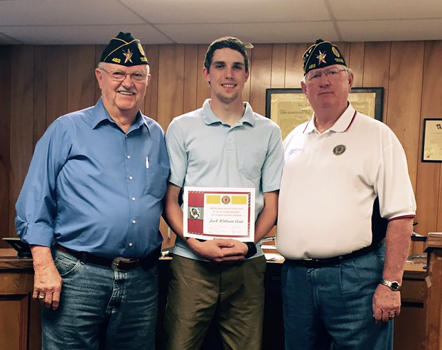 Red Henderson Post 483 Vice Commander Butch Burns and Commander Gary Thompson present Cooper High School senior Jack Cain with his $750 local American Legion scholarship.