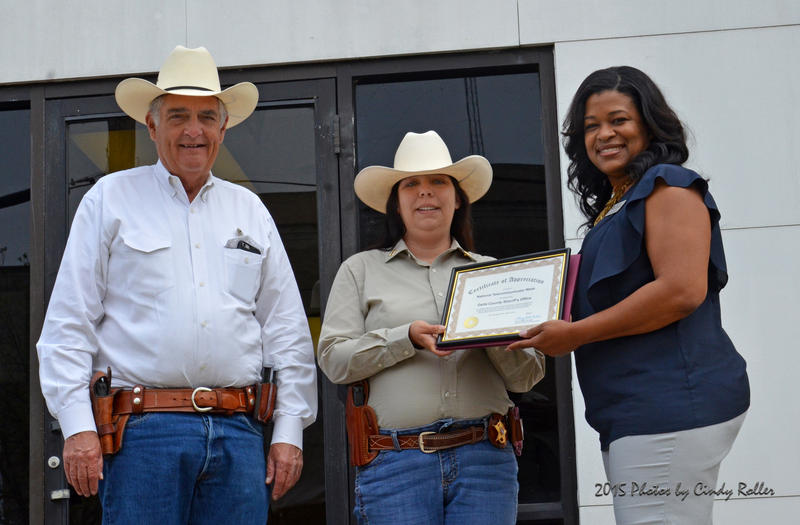 Sue Ann Johnson was accompanied by Delta County Sheriff Ricky Smith in accepting a certificate of appreciation for her service by Rea Washington, 9-1-1 Operations Coordinator for Ark-Tex Council of Governments.