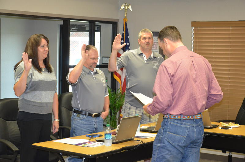 Trustees Mandy Freeman, Jeff Phifer and Darren Braddy were sworn in by Delta County Judge Jason Murray at Monday night's meeting.