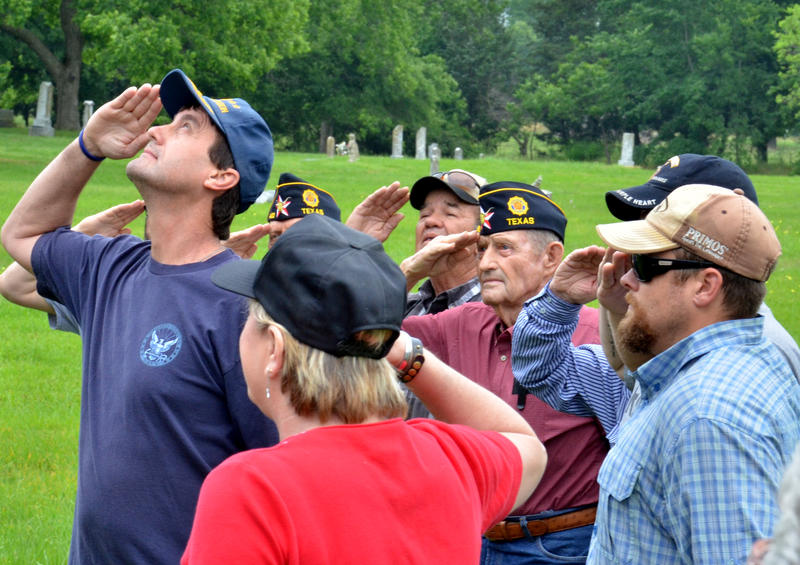 American Legion Red Henderson Post 483 salutes the American Flag during the Memorial Day program Saturday morning at Oaklawn Cemetery in Cooper.
