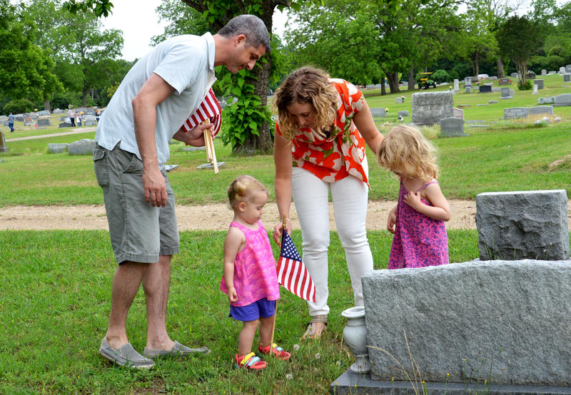 Families gather at local cemeteries in Delta County to honor the fallen.