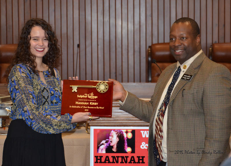 Hannah Kirby receives the key to the City of Sulphur Springs by Mayor Freddie Taylor.