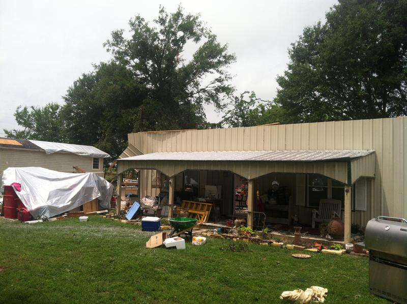 JoAnn Hill's home in far northwestern Smith County lost its roof and two of its walls in a May 10 tornado. Hill and her dog survived without injury.