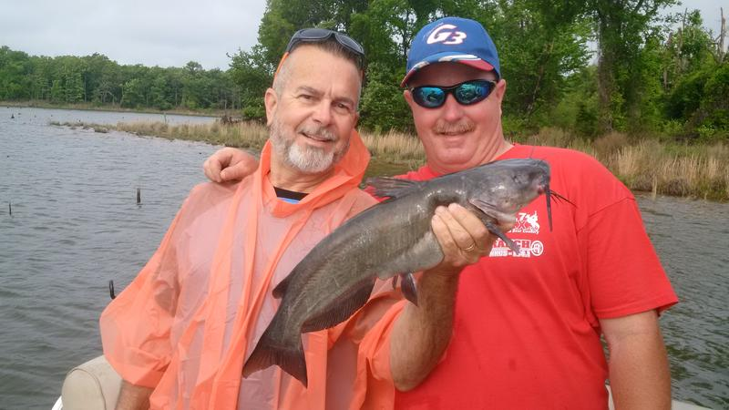 Lake Fork guide Seth Vanover (right) and Billy Kilpatrick show off one of many channel catfish landed last week.