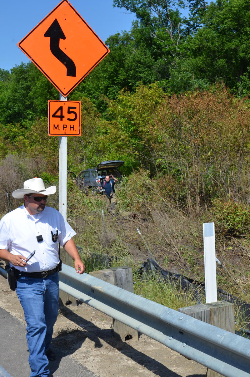 Delta County Deputy Marshall Lynch and Cooper Volunteer Fire Fighter Lewis Taylor examine the accident scene at John's Creek.
