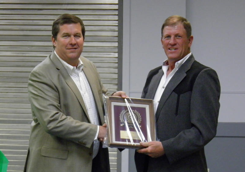 Steve Favre receives his award from David Basinger.