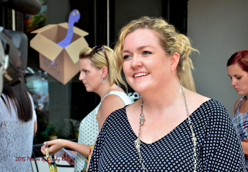 Colleen Hoover, author and The Bookworm Box owner, is interviewed during the 'Grey' book signing event Saturday.
