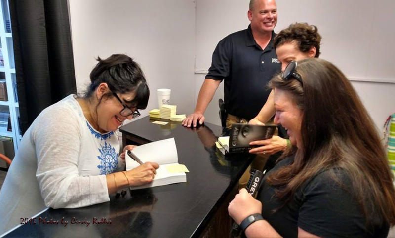 E L James pleasantly signing her autograph for over 500 of her copies of her newest book downtown Sulphur Springs, Texas.