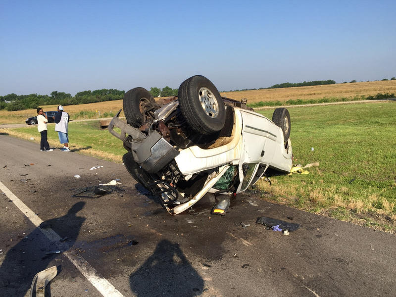 Driver walks away from rollover accident.