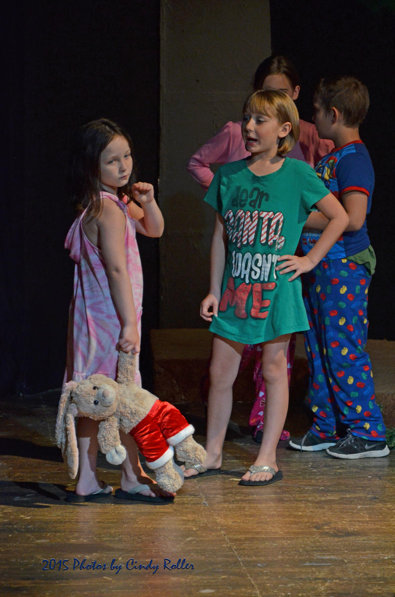 Children bicker over the belief in Santa Claus.