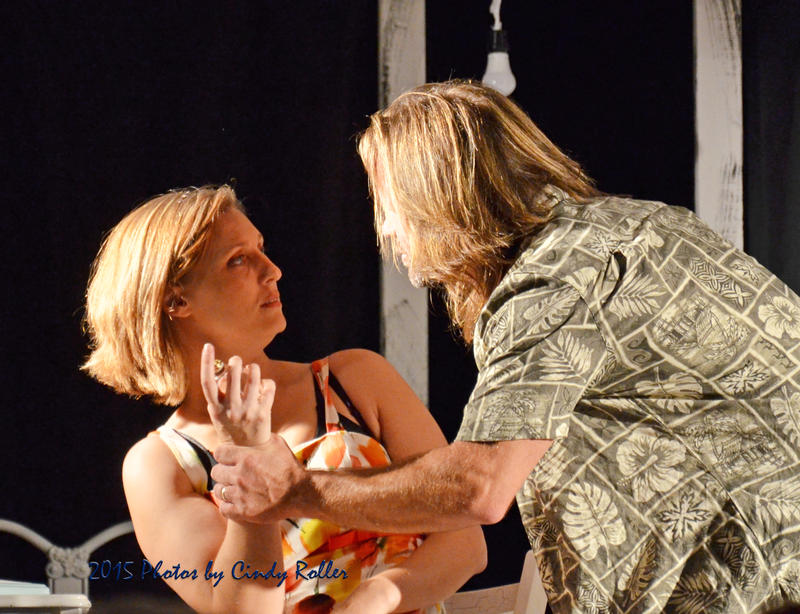 "Blanche played by Sarah Dicus is threatened by Stanley played by Michael Dicus in the play ""A Streetcar Named Desire."""