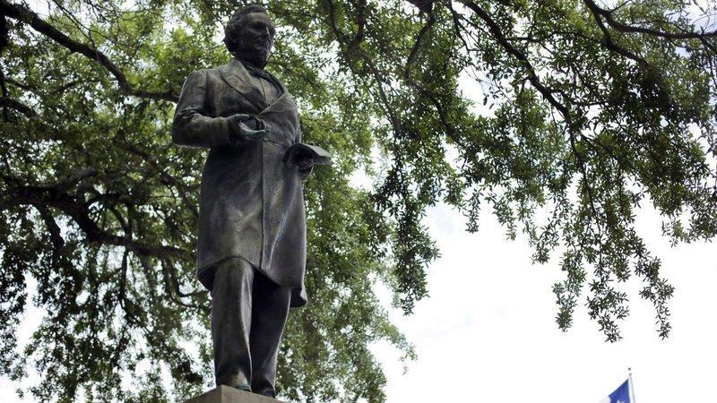 The statue of Jefferson Davis, once president of the Confederate States, stands just south of the Main Building on UT's campus