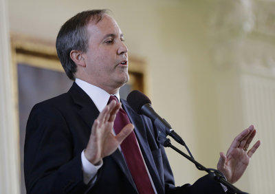Texas Attorney General Ken Paxton, seen here at his January swearing-in ceremony, has a long history of controversial business deals.