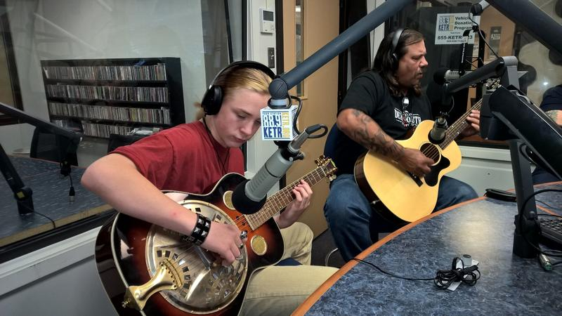 "Wade ""DR"" Holdsworth (left) and ""Diamond"" Jack Holdsworth performing a song in the KETR Studios."