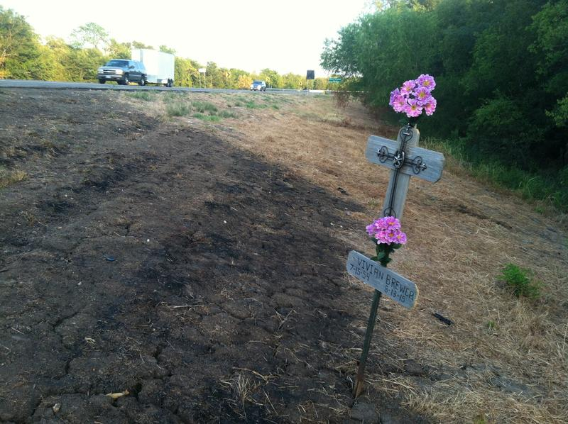 A cross marks the spot of a head-on collision that killed two people on State Highway 19 east of Cooper on Aug. 13.