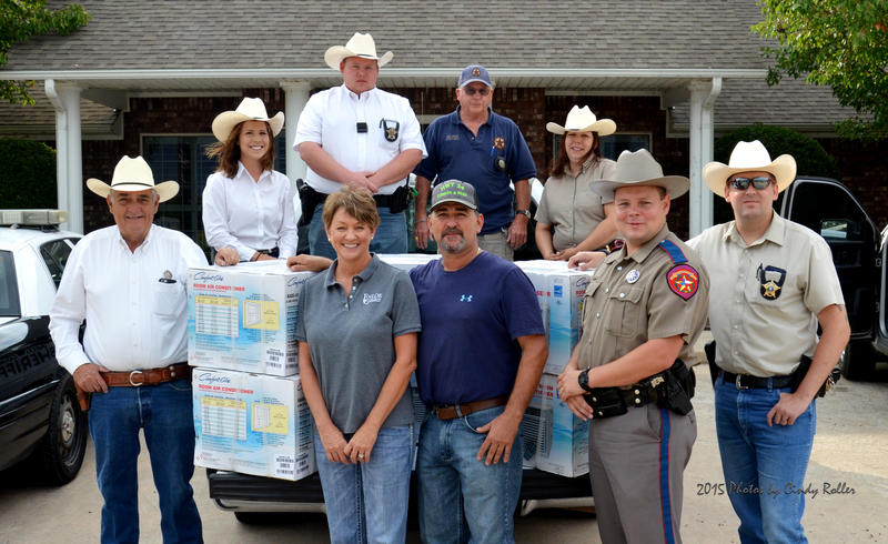 Local law enforcement, Enloe State Bank and HWY 24 Lumber and Feed donate window unit air conditions to those in need in Delta County.