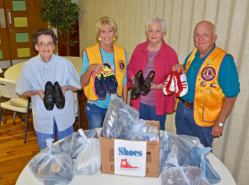 Billie Choate and Zelda Fisher helped collect 99 pairs of shoes for the Lions Club shoe drive which were accepted by Club members Brenda Stewart and Mayor Scotty Stegall.