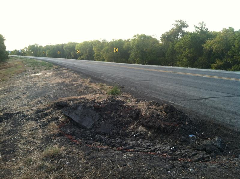 A rut along the shoulder of SH 19 is evidence of the deadly crash of Aug. 13.