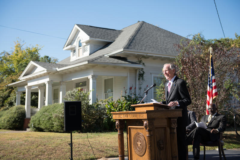 Texas A&M University-Commerce President Dan Jones, with the Chennault birthplace in the background.