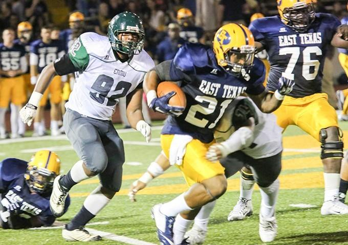 A&M-Commerce running backs Richard Cooper and Theo Wofford (21) combined for 287 yards during the Lions' 42-31 defeat of Eastern New Mexico in Commerce on Sept. 26, 2015.