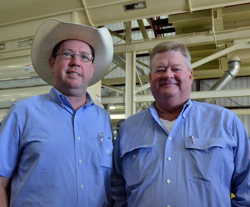 Delta County Extension Agent Alford Echols welcomes PPF Gin owner Pat Pilgrim.