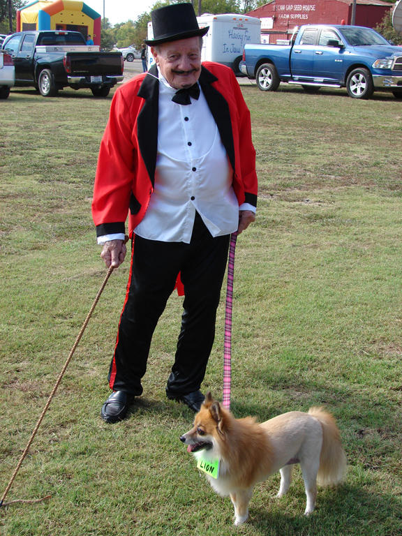 """Interesting characters like this Lion Tamer and his """"lion"""" were at Pecan Fest this year."""