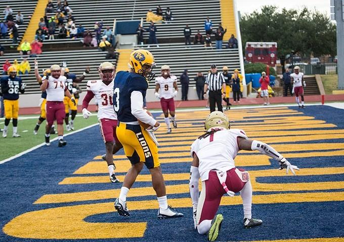 Lance Evans makes the catch over one of the best defenders in the conference.