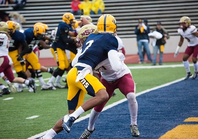 Lance Evans fights to make the catch over one of the best defenders in the conference.